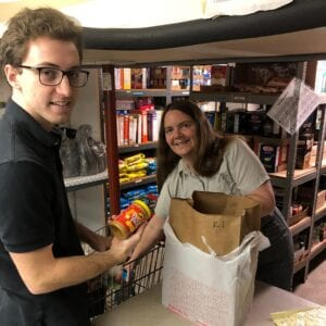 two people helping with food donations - Real Projectives