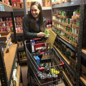 woman with shopping cart with food donations - Real Projectives   Maryland Private Equity, Advisory and Real Estate Project Management